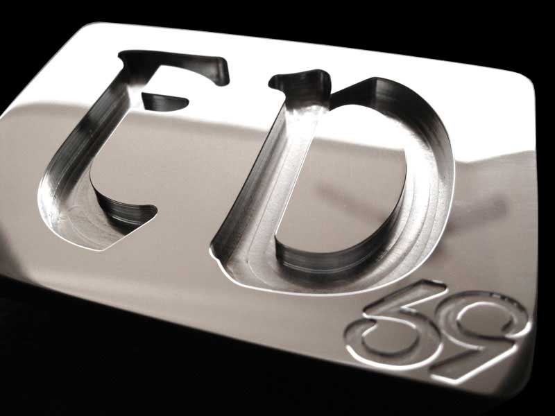 custom stainless steel belt buckle with ed initials milled into the face of the buckle