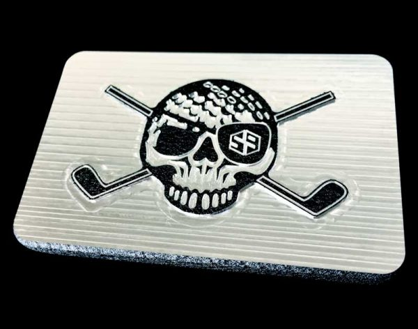 black belt buckle with a skull and crossed clubs pirate inspired design