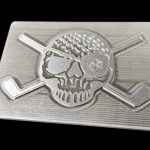 brushed silver belt buckle with a skull and crossed clubs pirate inspired design