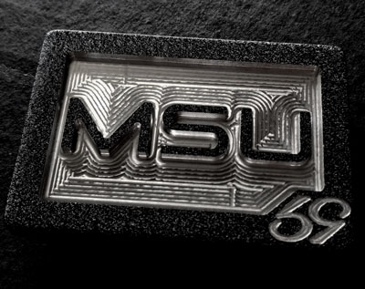 black unique belt buckle in black with msu college lettering