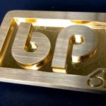 custom cnc milled brass trophy belt buckle with bp personal initials in a rounded font