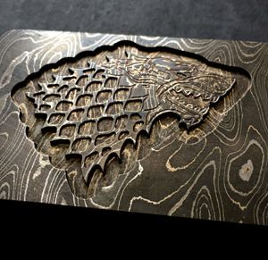 got wolf belt buckle cnc milled from solid damascus steel