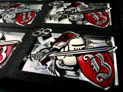 bakersfield college knight logo belt buckle red silver and black